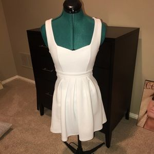 white sweetheart neck dress with open heart back